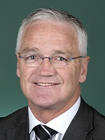 Official portrait of Damian Drum